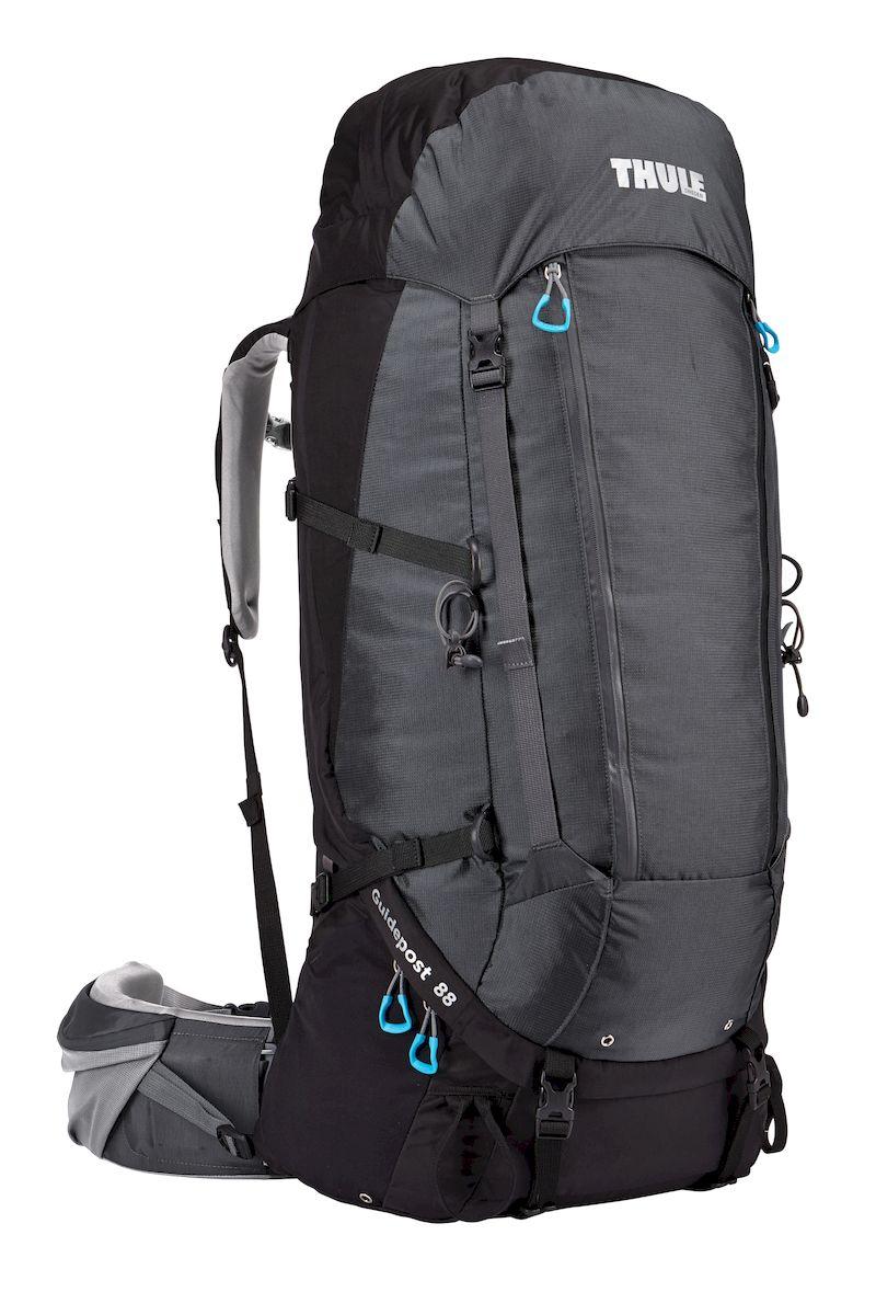 Рюкзак треккинговый мужской Thule Guidepost, цвет: черный, темно-серый, 88 л67742Мужской треккинговый рюкзак Thule Guidepost с объемом 88 создан для длительных путешествий. Отличается настраиваемой системой крепления TransHub, обеспечивающей идеальную посадку, поворачивающимся набедренным ремнем, который позволяет рюкзаку повторять ваши движения, и крышкой, способной трансформироваться в дополнительный рюкзак, который поможет вам покорить любую вершину.Легкая регулировка ремней для торса на 15 см обеспечивает идеальную посадку, а наплечные ремни QuickFit позволяют выбрать один из трех вариантов длины наплечных ремней.Система крепления Transhub с алюминиевой опорой и проволочным каркасом из пружинной стали позволяют перенести вес рюкзака на бедра, обеспечивая более удобную переноску. Поворачивающийся набедренный ремень позволяет рюкзаку повторять ваши движения, обеспечивая большую естественность передвижения и улучшенный баланс.Съемная крышка трансформируется в просторный рюкзак 24 л, позволяя сочетать два рюкзака в одном. Удобный доступ к содержимому рюкзака благодаря большой J-образной застежке на молнии на боковой панелиВоздухопроницаемая задняя панель обеспечивает поддержку в главных точках соприкосновения, но при этом позволяет воздуху циркулировать и не дает вам потеть. Два больших передних кармана на застежках-молниях предназначены для хранения часто используемых предметов Удобное хранение треккинговых палок или ледоруба при помощи двух петель-креплений. Два кармана на набедренном ремне с застежками-молниями и эластичные боковые карманы позволяют хранить бутылки, еду и другие мелкие предметы. Конструкция, предназначенная для хранения воды, включает внешний карман для бутылки с водой и обеспечивает удобный доступ к ней (бутылка продается отдельно).