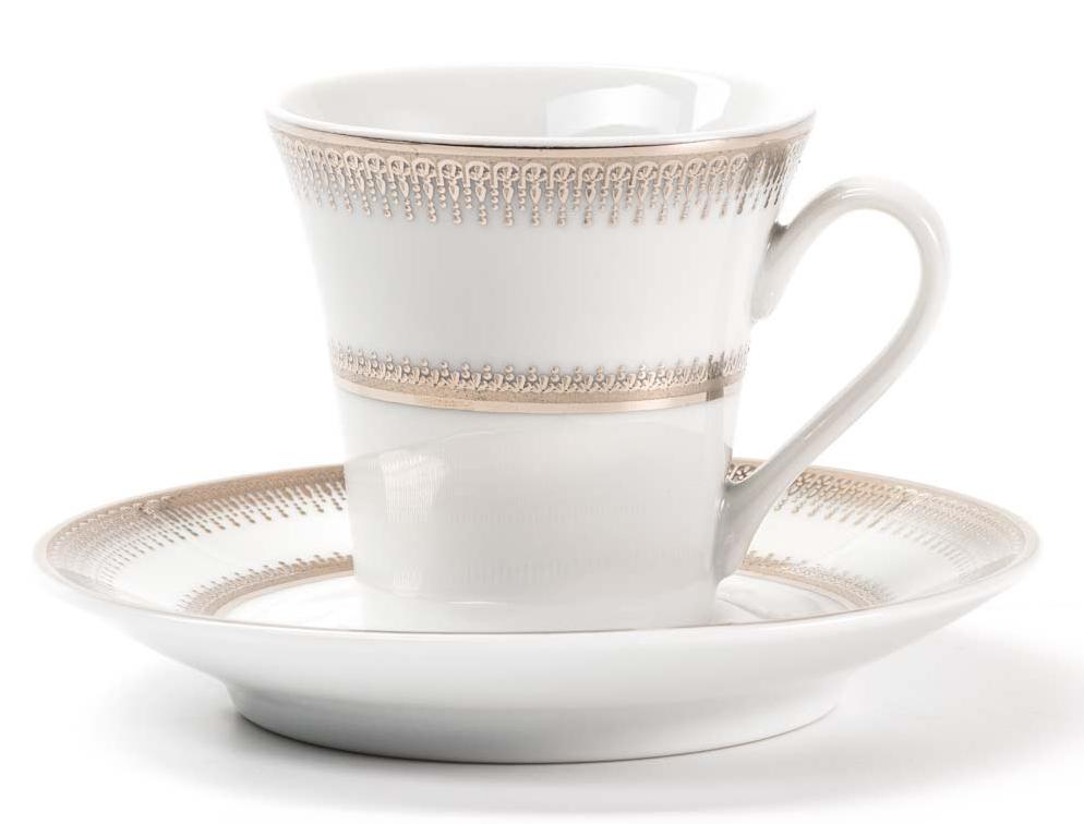 Набор чайных пар La Rose Des Sables Princier Platine, 12 предметовVT-1520(SR)Элегантная посуда класса люкс теперь на вашем столе каждый день. Сделанные из высококачественного материала с использованием новейших технологий, предметы сервировки невероятно прочны и прекрасно подходят для повседневного использования. Классическая форма и чистота линий делает их желанными гостями на любом обеде. Уникальная плотность и тонкость фарфора достигается за счет изготовления его из уникальной глины региона Лимож (Франция). Посуда устойчива к сколам и трещинам благодаря двойному термическому обжигу. Золотой, серебряный декор посуды отличается высоким содержанием настоящего золота и серебра.