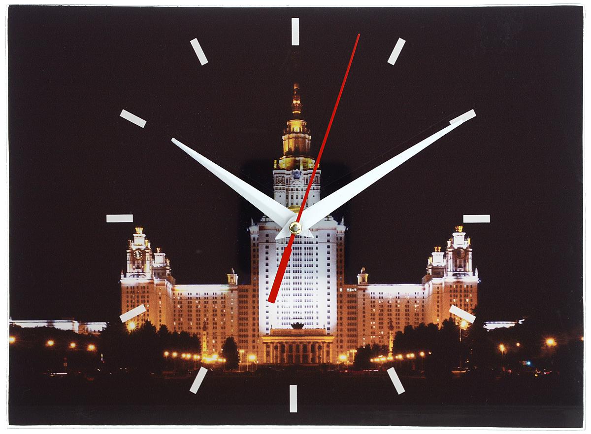 Часы настенные Эврика Москва, цвет: черный, белый 28 х 20 см300074_ежевикаНастенные часы Эврика Москва выполнены из прочного стекла с изображением ночной Москвы. Дизайн часов подчеркнет стиль вашего дома и украсит любую комнату. Циферблат оформлен отметками, часовой и минутной стрелками. Часы работают от одной батарейки типа АА напряжением 1,5V (в комплект не входит). С задней стороны имеется металлическая петелька для подвешивания на стену. Размер часов: 28 см х 20 см.