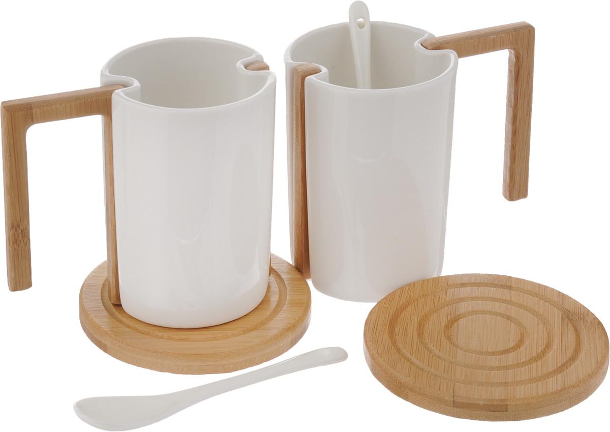 Набор чайный EcoWoo, 6 предметов24658Набор чайный EcoWoo - это не только идеальный подарок, но и прекрасный повод побаловать себя! Набор состоит из 2 фарфоровых кружек со съемными ручками, 2 бамбуковых подставок и 2 ложек.Такой набор станет идеальным решением для ценителей экологичных деталей в интерьере и поклонников здорового образа жизни.Не использовать в посудомоечной машине.Объем кружки: 280 мл.Диаметр кружки (по верхнему краю): 7,5 см.Высота кружки: 10 см.Диаметр подставки: 10 см.Длина ложки: 13 см.