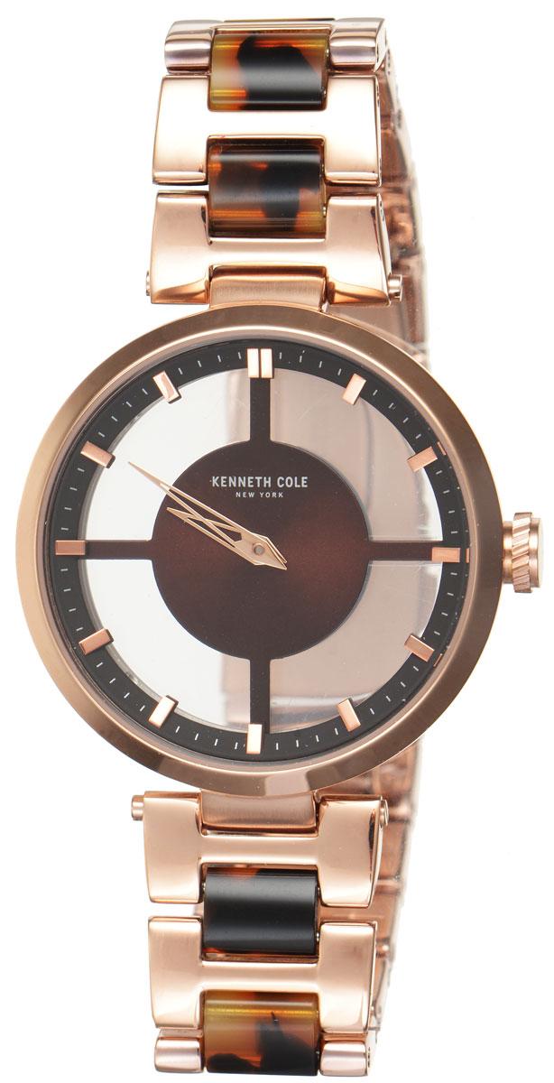 Часы наручные женские Kenneth Cole, цвет: золотой, коричневый. IKC4766BM8434-58AEСтильные женские часы Kenneth Cole выполнены из нержавеющей стали с PVD-покрытием и минерального стекла. Минималистичный циферблат изделия дополнен символикой бренда. Часы оснащены кварцевым механизмом с двумя стрелками, прозрачным корпусом, устойчивым к царапинам минеральным стеклом, степенью влагозащиты 3atm. Изделие дополнено ремешком из нержавеющей стали с PVD-покрытием, оснащенным удобной раскладывающейся застежкой, позволяющей максимально комфортно и быстро снимать и надевать часы. Часы поставляются в фирменной упаковке. Аксессуары Kenneth Cole очень стильные, но при этом весьма практичные. Их можно носить в любое время и в любой ситуации. Подход марки Kenneth Cole утилитарен, формы лаконичны, детали неожиданны.
