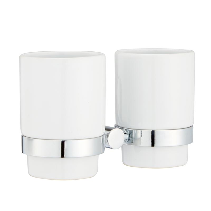 Стакан для зубных щеток Iddis Mirro Plus, двойной, цвет: хром391602Стакан для зубных щеток Iddis Mirro Plus изготовлен из латуни и матового стекла белого цвета. Изделие превосходно дополнит интерьер ванной комнаты.