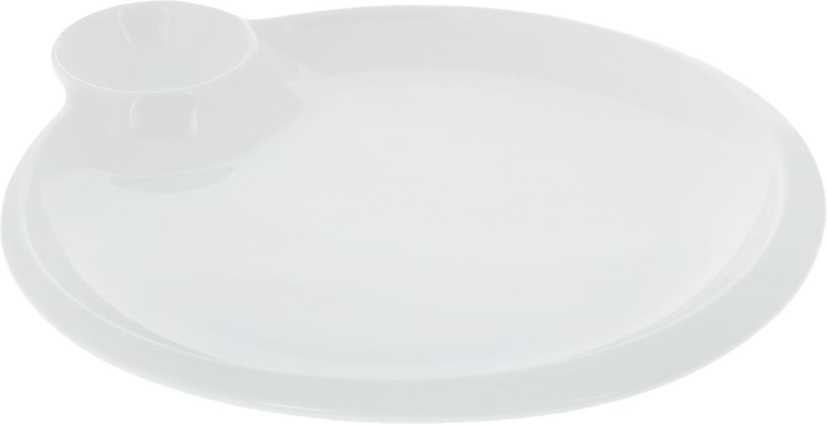 Блюдо Wilmax, диаметр 25 см. WL-992580 / A115510Оригинальное блюдо Wilmax, выполненное из высококачественного фарфора, имеет классическую круглую форму и оснащено соусником. Изделие идеально подойдет для сервировки праздничного или обеденного стола, а также станет отличным подарком к любому празднику.Диаметр блюда (по верхнему краю): 25 см. Диаметр соусника: 6,5 см.