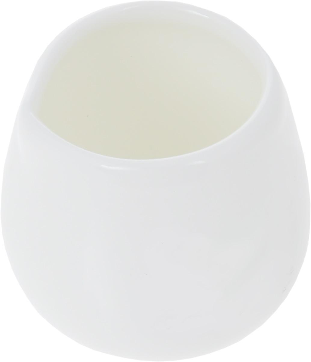 Молочник Wilmax, 50 мл115510Молочник Wilmax изготовлен из высококачественного фарфора, покрытого глазурью. Изделие предназначено для сервировки сливок или молока. Такой молочник отлично подойдет как для праздничного чаепития, так и для повседневного использования. Изделие функциональное, практичное и легкое в уходе. Диаметр (по верхнему краю): 3,5 см. Высота: 4,5 см.