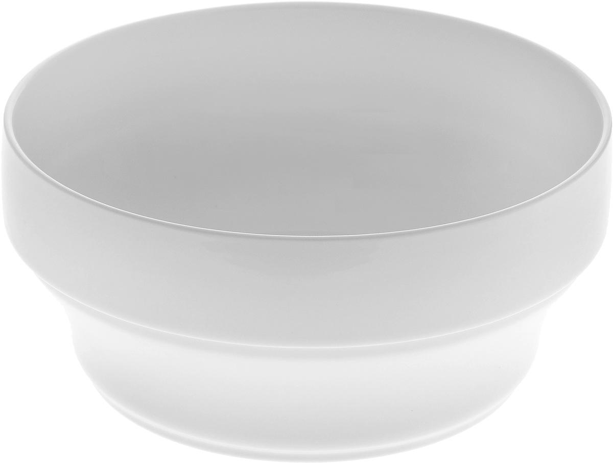Салатник штабелируемый Wilmax, 1,4 лFS-91909Элегантный салатник Wilmax выполнен из высококачественного фарфора с глазурованным покрытием. Салатник Wilmax прекрасно подойдет для подачи различных блюд: закусок, салатов или фруктов. Такой салатник украсит ваш праздничный или обеденный стол, а нежное исполнение понравится любой хозяйке.Можно мыть в посудомоечной машине и использовать в микроволновой печи. Диаметр салатника: 18 см. Высота стенок салатника: 8,5 см.