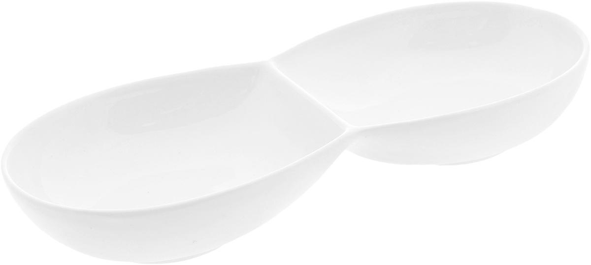 Менажница Wilmax, 2 секции. WL-99248754 009312Менажница Wilmax, изготовленная из высококачественного фарфора, состоит из 2 секций, выполненных в виде блюд. Изделие предназначено для подачи сразу нескольких видов закусок, нарезок, соусов и варенья.Оригинальная менажница Wilmax станет настоящим украшением праздничного стола и подчеркнет ваш изысканный вкус. Размер менажницы: 22,5 х 9,8 х 3,5 см.Размер секций: 11,5 х 9,8 см.