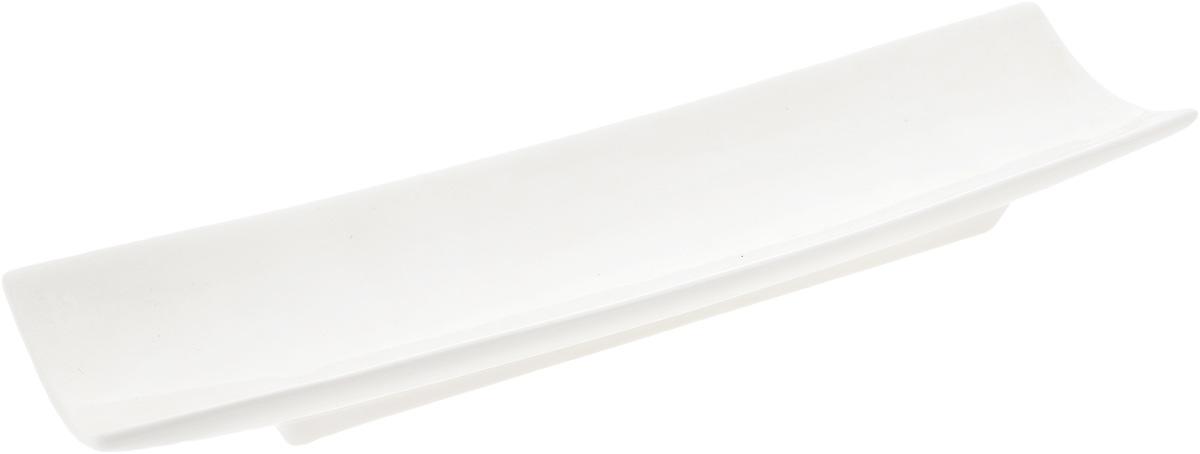 Блюдо Wilmax, 33 х 9 смVT-1520(SR)Оригинальное прямоугольное блюдо Wilmax, изготовленное из фарфора с глазурованным покрытием, прекрасно подойдет для подачи нарезок, закусок и других блюд. Оно украсит ваш кухонный стол, а также станет замечательным подарком к любому празднику.Размер блюда: 33 х 9 см.