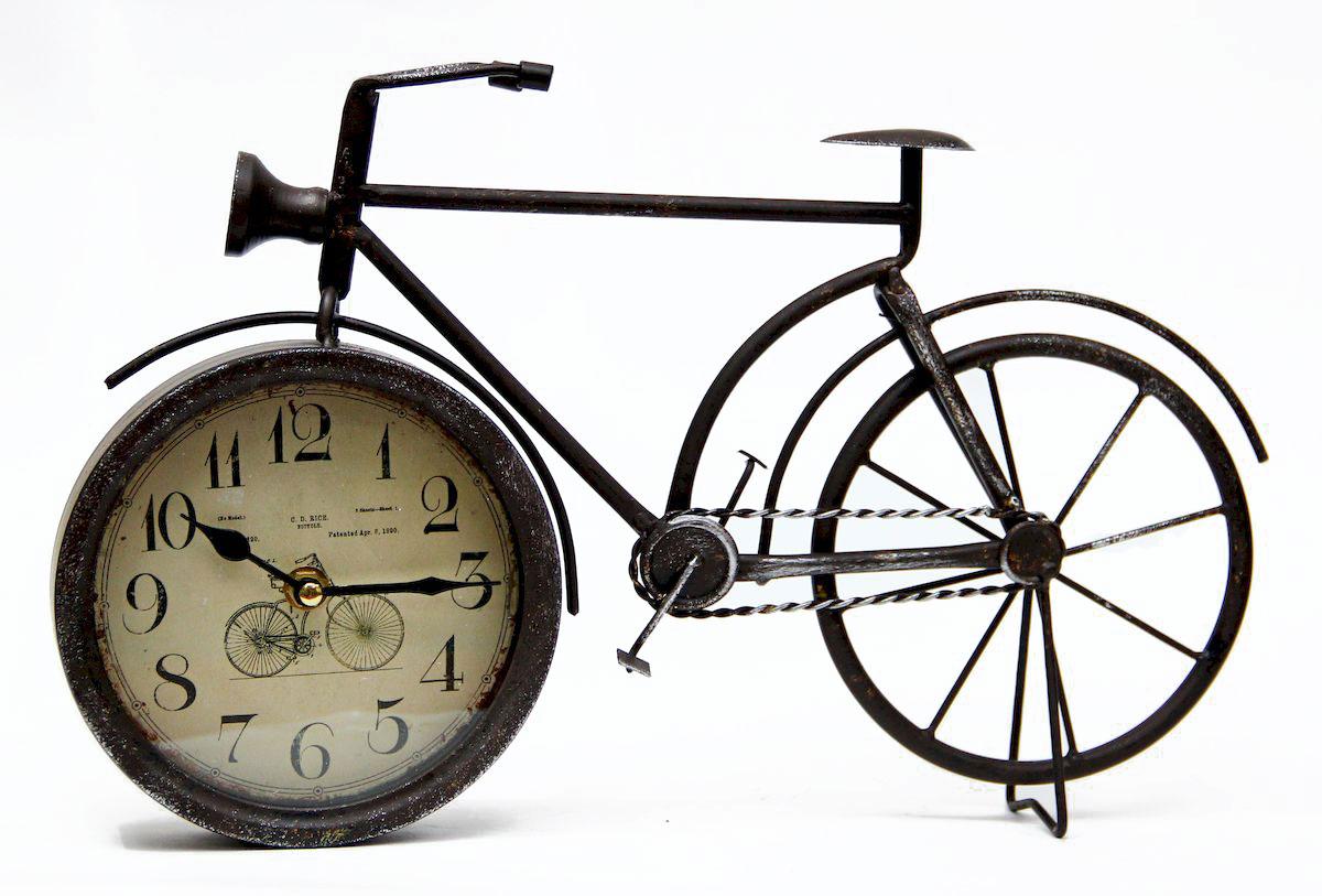 Часы настольные Magic Home Велосипед, кварцевые, цвет: черныйSC - WCD13MНастольные кварцевые часы Magic Home Велосипед изготовлены из металла черного цвета, циферблат из черного металла с покрытием из принтованной бумаги. Настольные часы Magic Home Велосипед прекрасно оформят интерьер дома или рабочий стол в офисе.Часы работают от одной батарейки типа АА мощностью 1,5V (не входит в комплект).