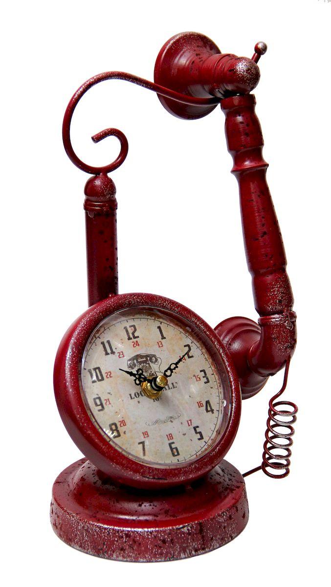 Часы настольные Magic Home Телефон, кварцевые, цвет: красный94672Настольные кварцевые часы Magic Home Телефон изготовлены из металла, циферблат с покрытием из принтованной бумаги. Настольные часы Magic Home Телефон прекрасно оформят интерьер дома или рабочий стол в офисе.Часы работают от одной батарейки типа АА мощностью 1,5V (не входит в комплект).Часы упакованы в пленку.