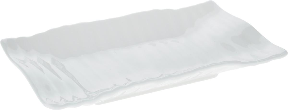 Блюдо Wilmax Японский стиль, 17,5 х 11,5 смVT-1520(SR)Оригинальное прямоугольное блюдо Wilmax Японский стиль, изготовленное из фарфора с глазурованным покрытием, прекрасноподойдет для подачи нарезок, закусок и других блюд. Фарфор от Wilmax изготовлен по уникальному рецепту из сплава магния и алюминия, благодаря чему посуда обладает характерной белизной, прочностью и устойчивостью к сколами. Особый состав глазури обеспечивает гладкость и блеск поверхности изделия.Оно украсит ваш кухонный стол, а также станет замечательным подарком к любому празднику.Можно мыть в посудомоечной машине и использовать в микроволновой печи. Изделие пригодно для использования в духовых печах и выдерживает температуру до 300°С.