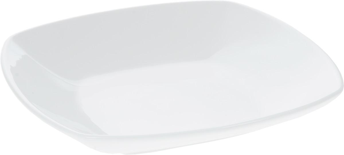 Тарелка глубокая Wilmax, 22 х 22 см54 009312Квадратная глубокая тарелка Wilmax изготовлена из фарфора с глазурованным покрытием. Фарфор от Wilmax изготовлен по уникальному рецепту из сплава магния и алюминия, благодаря чему посуда обладает характерной белизной, прочностью и устойчивостью к сколами. Особый состав глазури обеспечивает гладкость и блеск поверхности изделия.Изделие сочетает в себе изысканный дизайн с максимальной функциональностью. Тарелка прекрасно впишется в интерьер вашей кухни и станет достойным дополнением к кухонному инвентарю. Можно мыть в посудомоечной машине и использовать в микроволновой печи. Изделие пригодно для использования в духовых печах и выдерживает температуру до 300°С.