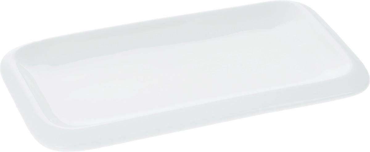 Блюдо Wilmax, 20 х 12 см115510Оригинальное прямоугольное блюдо Wilmax, изготовленное из фарфора с глазурованным покрытием, прекрасно подойдет для подачи нарезок, закусок и других блюд. Оно украсит ваш кухонный стол, а также станет замечательным подарком к любому празднику.Размер блюда: 20 х 12 см.