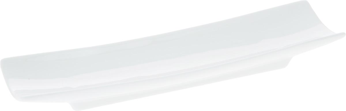 Блюдо Wilmax, 27,5 х 8 см2503000БОригинальное прямоугольное блюдо Wilmax, изготовленное из фарфора с глазурованным покрытием, прекрасноподойдет для подачи нарезок, закусок и других блюд. Фарфор от Wilmax изготовлен по уникальному рецепту из сплава магния и алюминия, благодаря чему посуда обладает характерной белизной, прочностью и устойчивостью к сколами. Особый состав глазури обеспечивает гладкость и блеск поверхности изделия.Оно украсит ваш кухонный стол, а также станет замечательным подарком к любому празднику.Можно мыть в посудомоечной машине и использовать в микроволновой печи. Изделие пригодно для использования в духовых печах и выдерживает температуру до 300°С.