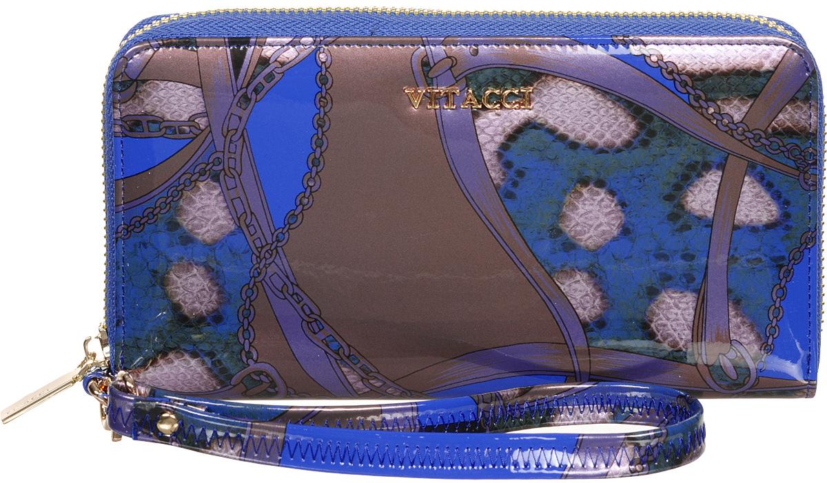 Кошелек женский Vitacci, цвет: синий. HS024W16-11135_914Модный женский кошелек Vitacci выполнен из натуральной лаковой кожи со змеиным принтом. Модель закрывается на застежку-молнию. Внутри 3 отделения для купюр, 2 потайных кармана, отделение для мелочи на застежке-молнии и 12 карманов для визиток и кредитных карт. Изделие дополнено съемным кожаным ремешком с замком-карабином. Такой кошелек станет прекрасным стильным подарком для любителей респектабельных аксессуаров и порадует простотой и функциональностью.Изделие упаковано в фирменную коробку.