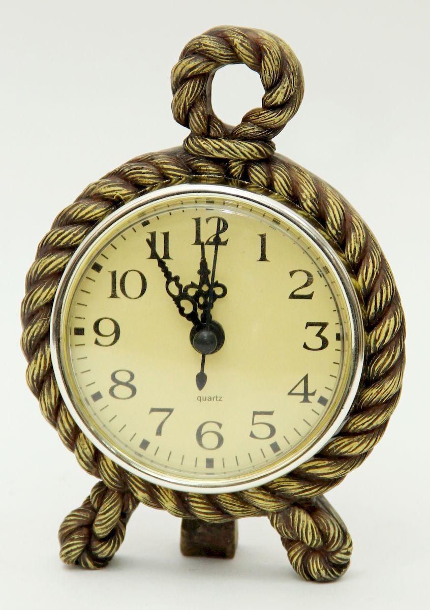 Часы настольные Magic Home Морской узел, цвет: бронзовый94672Настольные кварцевые часы Magic Home Морской узел изготовлены из полирезина, циферблат изготовлен из прочного пластика. Настольные часы Magic Home Морской узел прекрасно оформят интерьер дома или рабочий стол в офисе.Элемент питания не входит в комплект.