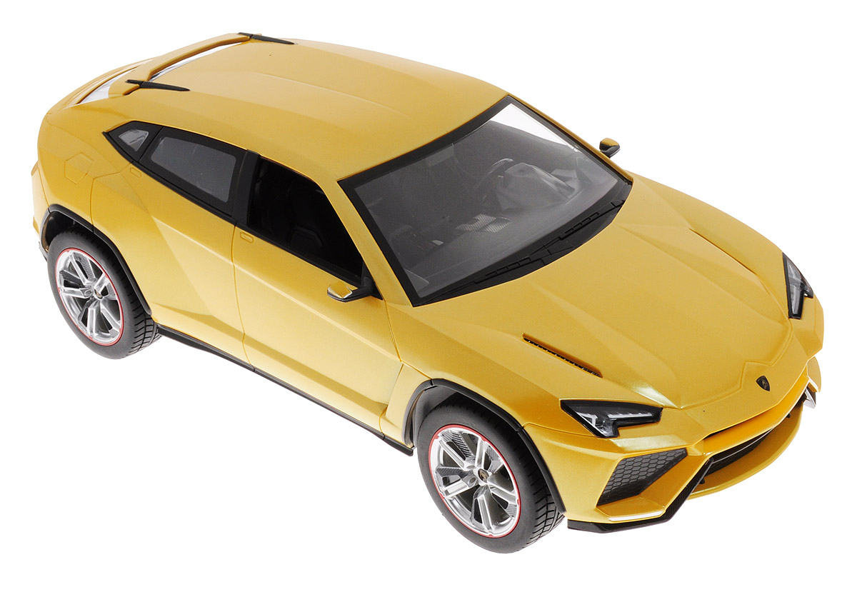 """Радиоуправляемая модель Rastar """"Lamborghini Urus"""" очень детально воспроизводит реальный автомобиль. Такая модель автомобиля станет отличным подарком не только автолюбителю, но и человеку, ценящему оригинальность и изысканность, а качество исполнения представит такой подарок в самом лучшем свете. Модель выполнена из пластика с металлическими элементами и оснащена световыми эффектами. Маневренная и реалистичная уменьшенная копия выполнена в точной детализации с настоящим автомобилем в масштабе 1:14. На пульте расположены 4 кнопки (вперед - назад, вправо - влево). Пульт управления с удобными держателями позволит ребенку играть с машинкой хоть сидя, хоть стоя. Радиоуправляемые игрушки способствуют развитию координации движений, моторики и ловкости. Машина работает от 5 батареек типа АА (не входят в комплект). Пульт управления работает от батарейки 9V типа """"Крона"""" (не входит в комплект)."""