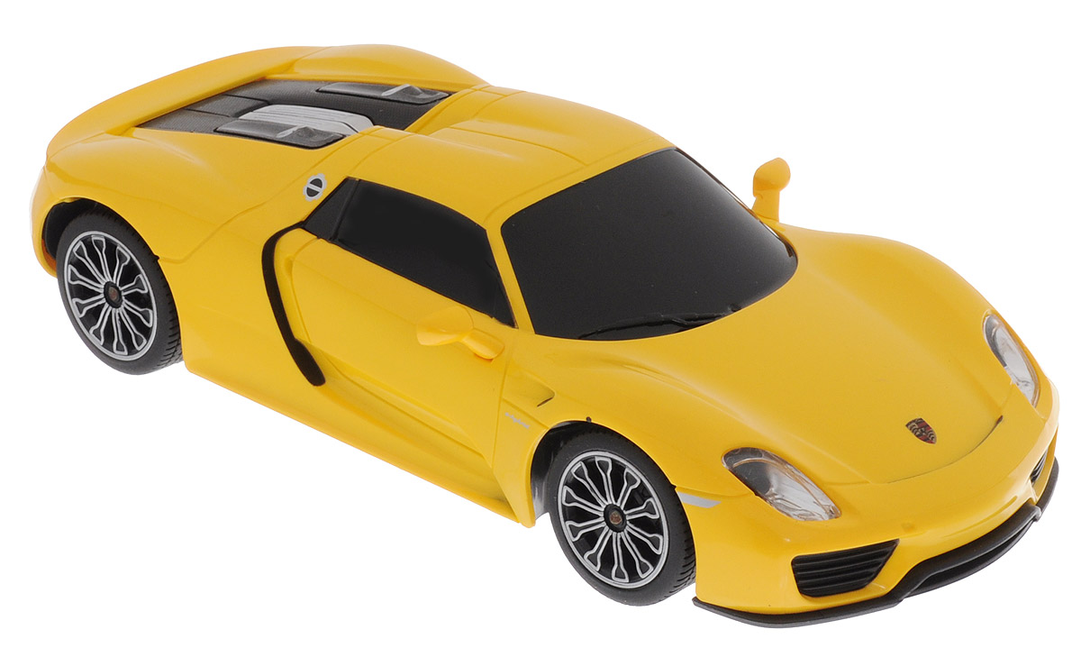 """Радиоуправляемая модель Rastar """"Porsche 918 Spyder"""" является точной копией настоящего автомобиля в масштабе 1/24. Управление автомобилем происходит с помощью удобного пульта. Машина двигается вперед и назад, поворачивает направо и налево, останавливается. Колеса игрушки прорезинены и обеспечивают плавный ход, машинка не портит напольное покрытие. Радиоуправляемые игрушки способствуют развитию координации движений, моторики и ловкости. Ваш ребенок увлеченно будет играть с моделью, придумывая различные истории и устраивая соревнования. Порадуйте его таким замечательным подарком! Машина работает от 3 батареек напряжением 1,5V типа АА (не входят в комплект). Пульт управления работает от 2 батареек напряжением 1,5V типа АА (не входят в комплект)."""