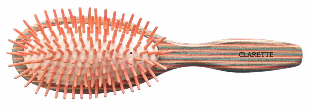 Clarette Щетка для волос массажная на подушке большая, цвет: красныйCPB 613Clarette представляет эксклюзивную коллекцию инструментов по уходу за волосами из натурального дерева. Коллекция Clarette Цветное дерево-это расчески и щетки для волос из натурального дерева. Коллекция выполнена в оригинальной радужной цветовой гамме по специальной технологии. Окрашенная в различные цвета, основа щетки, как бы повторяет структуру натурального дерева в срезе. Это делает коллекцию яркой и неповторимой. Щетка с натуральными, деревянными зубьями бережно ухаживает за волосами, не повреждая их структуру.