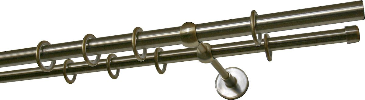 Карниз двухрядный Уют Ост, металлический, составной, цвет: бронза, диаметр 20 мм, длина 3,2 м1004900000360Двухрядный круглый карниз Уют Ост выполнен из цинко-алюминиевого сплава с гальваническим покрытием. Подходит для использования двух видов занавесей. Поверхность гладкая. Способ крепления настенное. Возможно сочетание штанг различных диаметров и цветов. В комплект входят 4 штанги, 2 соединителя, 3 кронштейна с крепежом и 64 кольца с крючками. Наконечникиприобретаются дополнительно.Такой карниз будет органично смотреться в любом интерьере.Диаметр карниза: 20 мм.