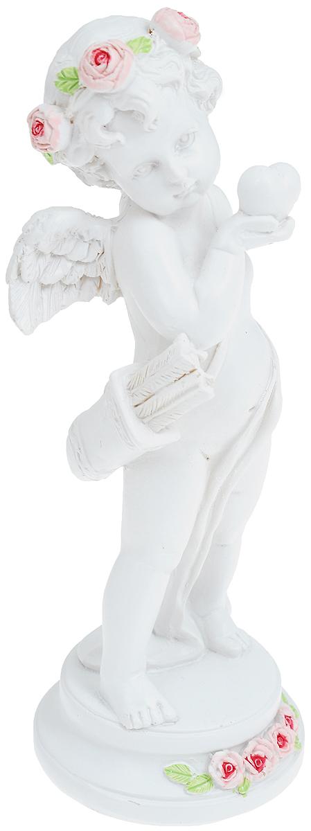 Фигурка декоративная Феникс-Презент Ангел с сердцем, высота 16,6 см670130Фигурка декоративная Феникс-Презент Ангел с сердцем, выполненная из полирезины, станет оригинальным подарком для всех любителей необычных вещей. Она выполнена в классическом стиле в виде Купидона со стрелами и луком, в венке из роз и с сердцем в руке. Изысканный сувенир станет прекрасным дополнением к интерьеру. Вы можете поставить фигурку в любом месте, где она будет удачно смотреться и радовать глаз.
