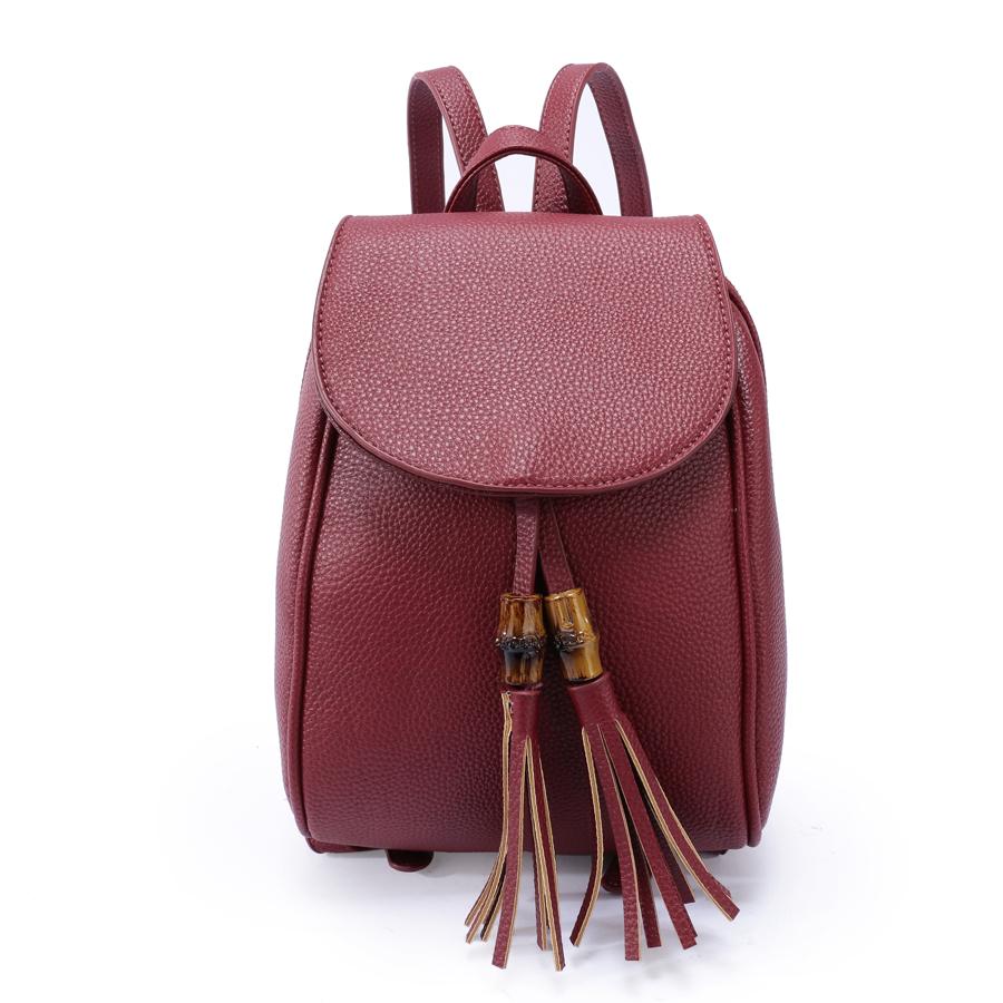 Рюкзак женский Orsa Oro, цвет: марсала. D-172/30S76245Стильный женский рюкзак Orsa Oro выполнен из экокожи с зернистой фактурой и декорирован кисточками. Изделие с клапаном на магнитной кнопке содержит одно отделение, застегивается на молнию. Внутри расположены один накладной карман, врезной карман на молнии и карман-средник на молнии. Лицевая сторона рюкзака дополнена плоским карманом, задняя - карманом на молнии. Рюкзак оснащен удобными плечевыми лямками регулируемой длины, а также петлей для подвешивания.