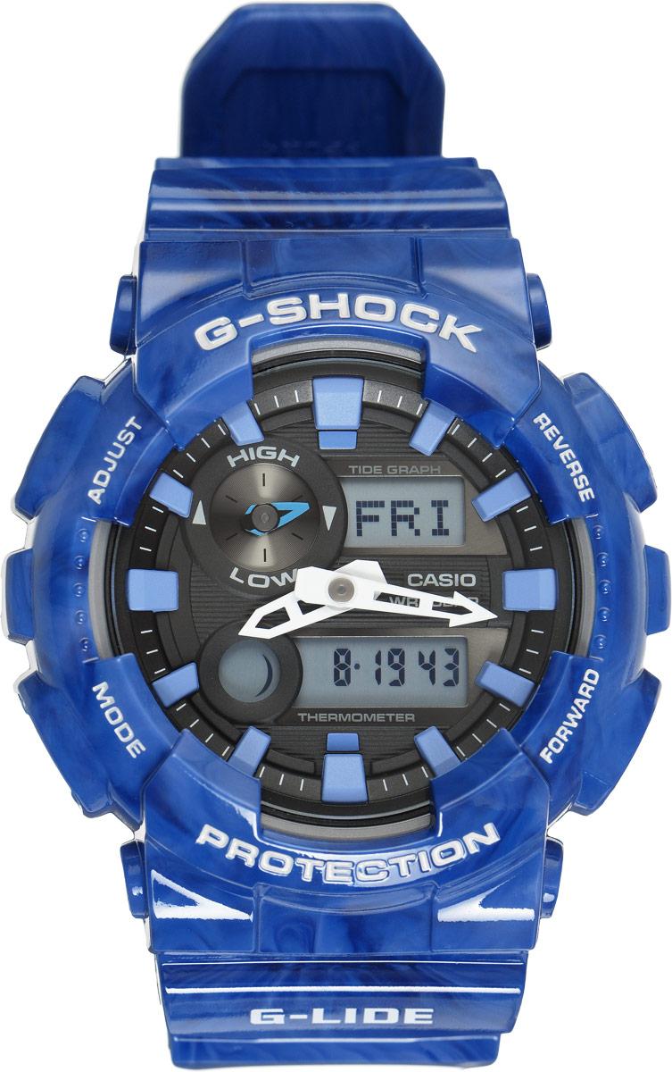 Часы наручные мужские Casio G-Shock, цвет: синий, черный. GAX-100MA-2ABM8434-58AEУдаропрочные часы G-Lide имеют все свойства и преимущества знаменитых G-Shock от Casio и, в соответствии с морской концепцией, отображают высоту приливов/отливов и лунные фазы. Двойная цифро-аналоговая индикация и встроенный датчик температуры - эти часы определенно подойдут любителям экстремальных видов спорта. Ударопрочная конструкция защищает механизм от ударов и вибрации. Изделие защищено от магнитных полей. Комбинированный корпус выполнен из нержавеющей стали 316L и композитного полимерного материала, оснащен минеральным стеклом, устойчивым к возникновению царапин. Ремешок также выполнен из полимерного материала и оснащен надежной классической застежкой с двойным шипом. Циферблат подсвечивается светодиодом, а умная и приятная функция автоподсветки освещает циферблат при повороте часов к лицу. Помимо этого стоит отметить еще люминесцентный состав на стрелках и часовых метках с ярким послесвечением даже после кратковременного воздействия света. Часы оснащены кварцевым механизмом с двойной цифро-аналоговой индикацией при помощи многофункциональных стрелок и на жидкокристаллическом дисплее и имеют степень влагозащиты равную 200 Bar, что отлично подходит для погружения под воду с аквалангом. Среди удобных функций также имеется секундомер с точностью показаний 1/100 с и временем измерения 1000 ч, сплит-хронограф, таймер обратного отсчета от 1мин до 24ч и 5 ежедневных будильников, устанавливаемых на определенное время. Часы Casio G-Shock - это обдуманный выбор сильных мужчин.