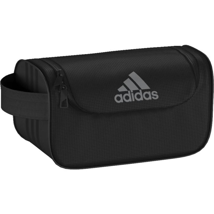 Косметичка Adidas, цвет: черный. AK0021332515-2358Стильная косметичка для туалетных принадлежностей. Спортивная косметичка для удобного хранения принадлежностей для душа и предметов личной гигиены. Основное отделение на молнии; внутренний карман на молнииБоковая ручкаТональные три полоски сбокуЛоготип adidas на лицевой стороне