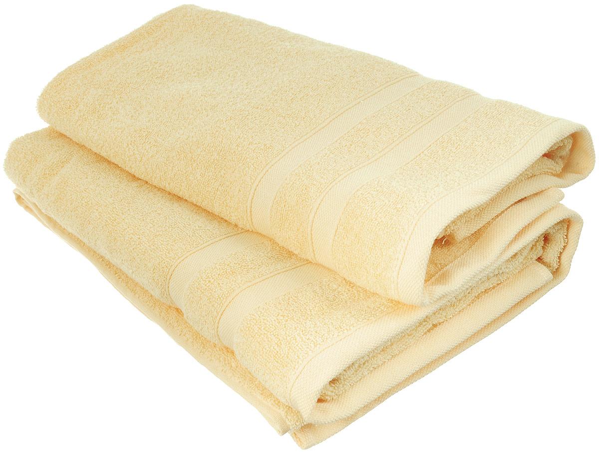 Набор хлопковых полотенец Home Textile, цвет: желтый, 2 шт1004900000360Набор Home Textile состоит из двух полотенец разного размера, выполненных из качественной натуральной махры (100% хлопок). Полотенца имеют гладкую, приятную на ощупь текстуру, край украшен классическим двойным бордюром. Мягкие и уютные, они прекрасно впитывают влагу и легко стираются. Кроме того, хлопковые полотенца отличаются высокой износоустойчивостью и долгим сроком службы. Такой набор полотенец подарит массу положительных эмоций и приятных ощущений.Размеры полотенец: 50 х 90 см; 70 х 140 см.