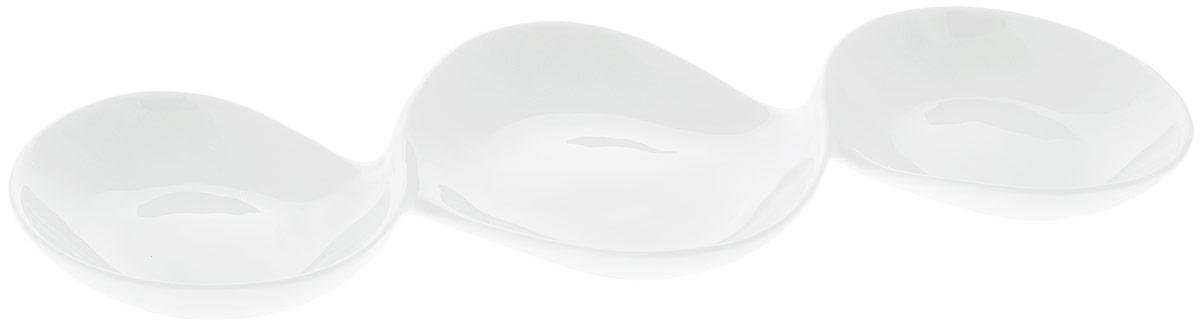 Менажница Wilmax, 3 секции, 37 х 17 см115510Менажница Wilmax изготовлена из высококачественного фарфора с глазурованным покрытием. Материал легкий, тонкий, свет без труда проникает сквозь изделие. Посуда имеет роскошную белизну, гладкость и блеск достигаются за счет особой рецептуры глазури. Изделие обладает низкой водопоглощаемостью, высокой термостойкостью и ударопрочностью, а также экологичностью. Посуда долговечна и рассчитана на постоянное интенсивное использование. Гладкая непористая поверхность исключает проникновение бактерий, изделие не будет впитывать посторонние запахи и сохранит первоначальный цвет. Менажница прекрасно подойдет для подачи различных закусок, нарезок, сладостей, фруктов. Она оснащена 3 секциями для подачи сразу нескольких видов закусок. Изделие украсит ваш праздничный или обеденный стол, а оригинальный дизайн придется по вкусу и ценителям классики, и тем, кто предпочитает утонченность и изысканность.Можно мыть в посудомоечной машине и использовать в микроволновой печи. Размер центральной секции: 17 х 13 см.