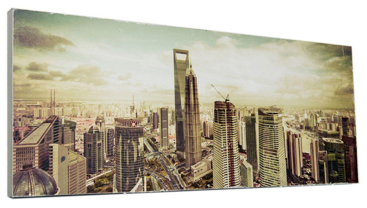 Картина Mister Poster Величественные высотки, 60 х 24 смRG-D31SКартина Mister Poster - это высококачественная репродукция на деревянной раме. Лицевая поверхность имитирует штукатурку или натуральный холст, края окрашены вручную специальным декоративным составом.Современные технологии, уникальное оборудование и оригинальные чернила, используемые при изготовлении, делают постер устойчивым к выцветанию, а также гарантируют стойкость к воздействию негативных внешних факторов. Интерьер дома и офиса, в котором находится человек, в значительной степени влияет на его настроение и работоспособность. Правильное оформление интерьера создает благоприятный психологический климат, улучшает настроение и мотивирует. Добавьте «красок» в ваш интерьер и, возможно, в вашу жизнь.