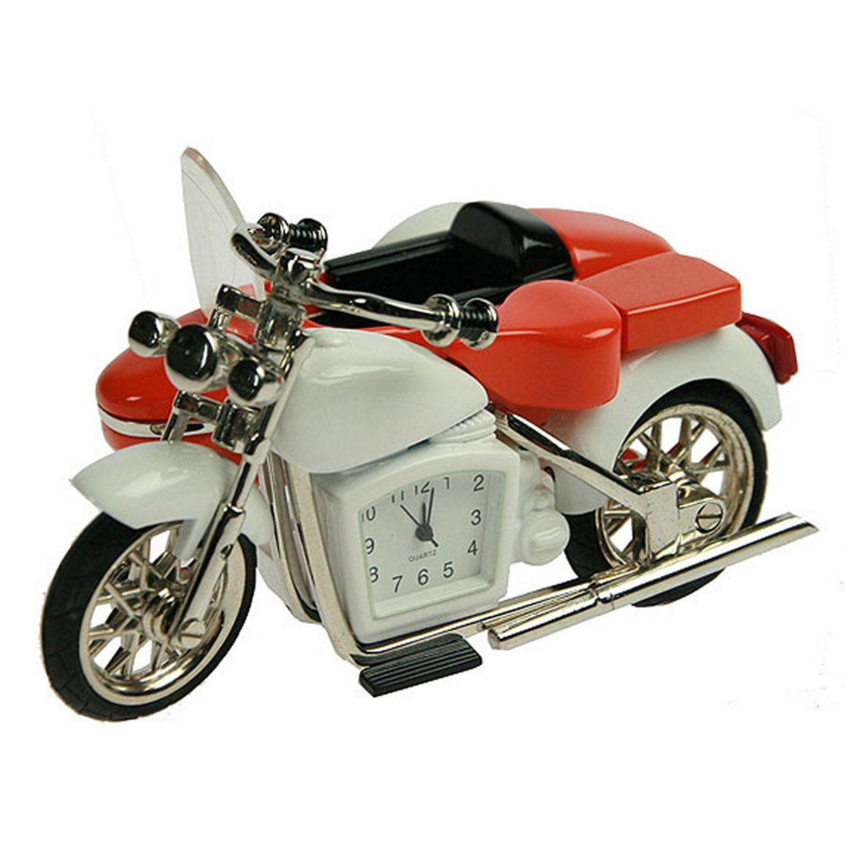 Часы настольные Русские Подарки Мотоцикл, 7 х 10 х 5 см. 22425В76Настольные кварцевые часы Русские Подарки Мотоцикл изготовлены из металла. Корпус оригинально оформлен в виде мотоцикла. Часы имеют три стрелки - часовую, минутную и секундную.Такие часы украсят интерьер дома или рабочий стол в офисе. Также часы могут стать уникальным, полезным подарком для родственников, коллег, знакомых и близких.Часы работают от батареек типа SR626 (в комплект не входят).