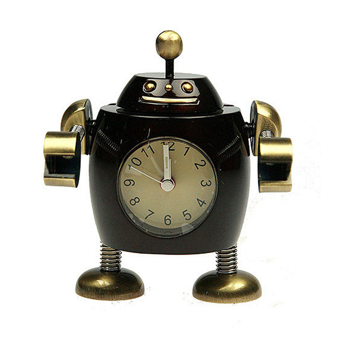 Часы настольные Русские Подарки Робот. 2243354 009318Настольные кварцевые часы Русские Подарки Робот изготовлены из металла. Изделие оригинально оформлено в виде робота. Часы имеют три стрелки - часовую, минутную и секундную.Такие часы украсят интерьер дома или рабочий стол в офисе. Также часы могут стать уникальным, полезным подарком для родственников, коллег, знакомых и близких.Часы работают от батареек типа SR626 (в комплект не входят).