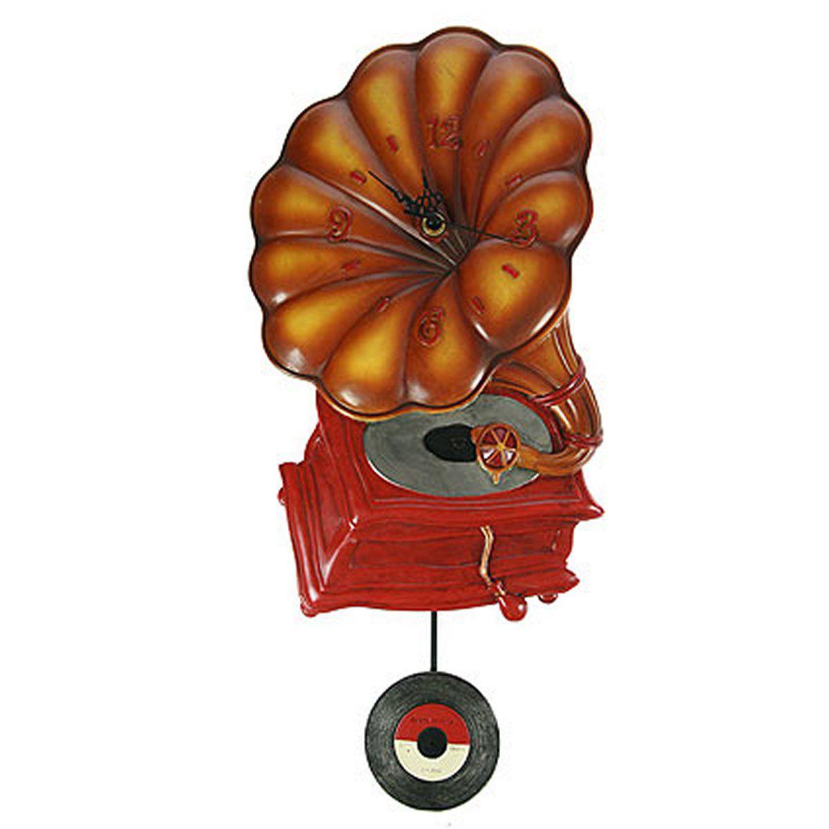 Часы настенные Русские Подарки Граммофон, с маятником, 25 х 7 х 52 см. 224864300173Настенные кварцевые часы с маятником Русские Подарки Граммофон изготовлены из полистоуна. Корпус выполнен в виде старинного граммофона. Часы имеют три стрелки - часовую, минутную и секундную. С обратной стороны имеетсяпетелька для подвешивания на стену. Изящные часы красиво и оригинально оформят интерьер дома или офиса. Также часы могут стать уникальным, полезным подарком для родственников, коллег, знакомых и близких.Часы работают от батареек типа АА (в комплект не входят).