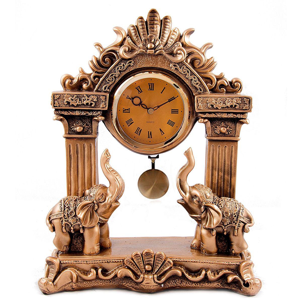 Часы настольные Русские Подарки Слоны, 30 х 13 х 37 см. 5933359333Настольные часы Русские подарки Слоны - очень оригинальные и стильные настольные часы. Корпус выполнен из полистоуна. Они прекрасно впишутся практически в любой интерьер и станут превосходным украшением вашей комнаты. Это красивый и практичный подарок на любое торжество для родных и близких.