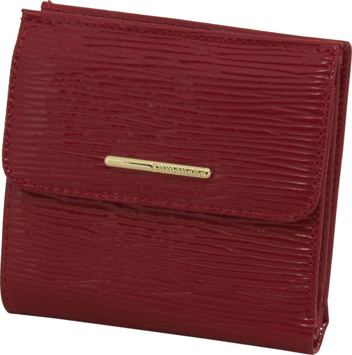 Кошелек женский Dimanche Найс, цвет: темно-красный. 142W16-11135_914Кошелек Dimanche выполнен из натуральной лаковой кожи с декоративным тиснением и оформлен металлической пластинкой с названием бренда. На лицевой стороне расположен объемный карман для мелочи, который закрывается клапаном с кнопкой. Внутри расположено два открытых кармана для купюр, карман для купюр на молнии, два кармана для кредиток, карман для sim-карты, карман с пластиковым окошком для документов и два вертикальных кармана. Изделие закрывается на кнопку.