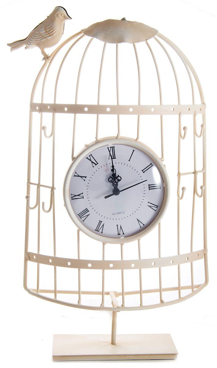 Часы настольные Русские Подарки Очарование прованса, 23 х 10 х 47 см. 60603148115Настольные кварцевые часы Русские Подарки Очарование прованса изготовлены из металла, циферблат защищен стеклом. Корпус оригинально оформлен в виде клетки с птичкой. Часы имеют три стрелки - часовую, минутную и секундную.Такие часы украсят интерьер дома или рабочий стол в офисе. Также часы могут стать уникальным, полезным подарком для родственников, коллег, знакомых и близких.Часы работают от батареек типа АА (в комплект не входят).