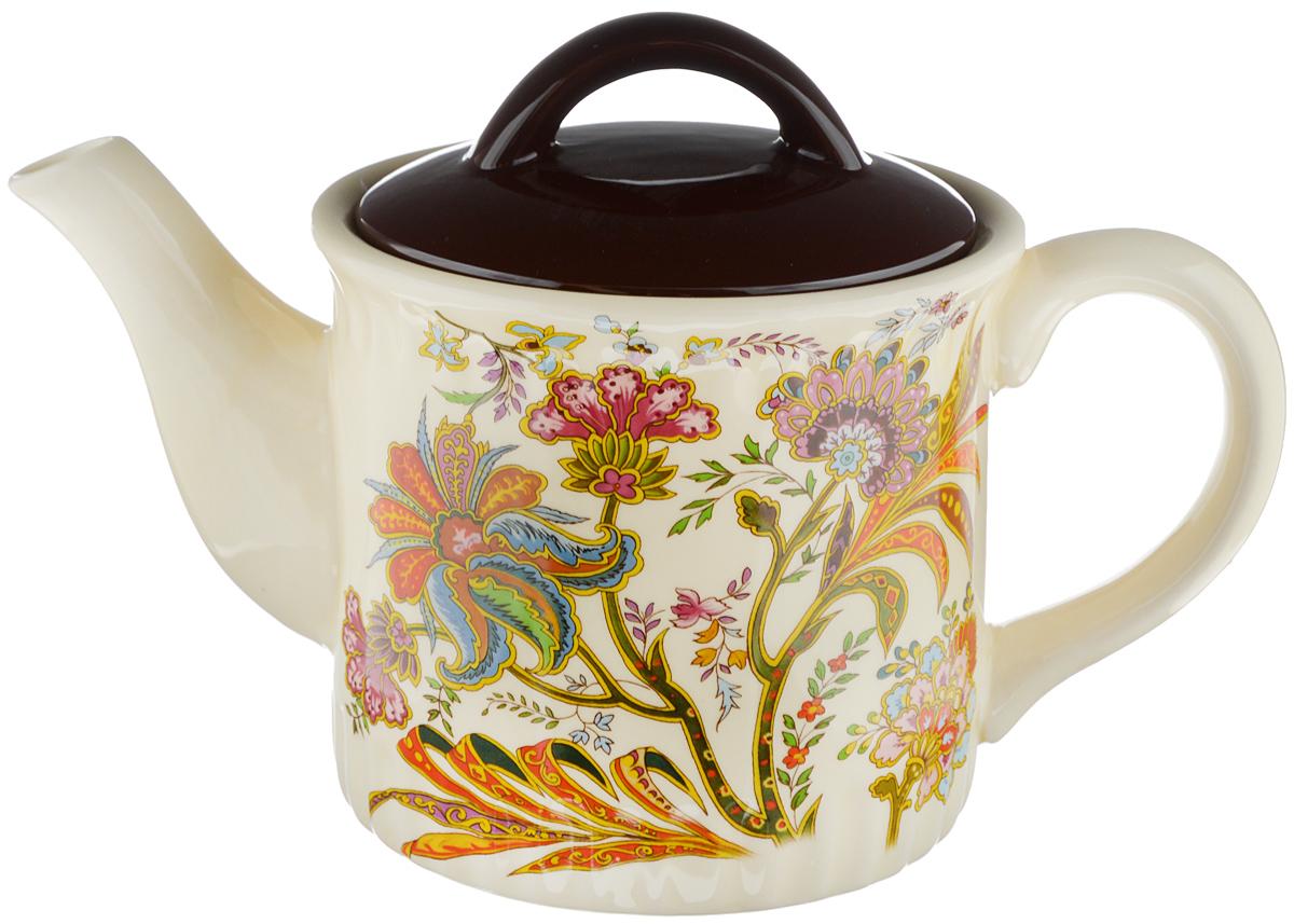 Чайник заварочный Loraine, 850 мл391602Заварочный чайник Loraine изготовлен из высококачественной керамики и оформлен красочным рисунком. Гладкая и идеально ровная поверхность обеспечивает легкую очистку. Чайник поможет заварить крепкий ароматный чай и великолепно украсит стол к чаепитию. Можно использовать в микроволновой печи и мыть в посудомоечной машине. Диаметр чайника (по верхнему краю): 9,5 см. Высота чайника (без учета крышки): 11,5 см.Объем чайника: 850 мл.