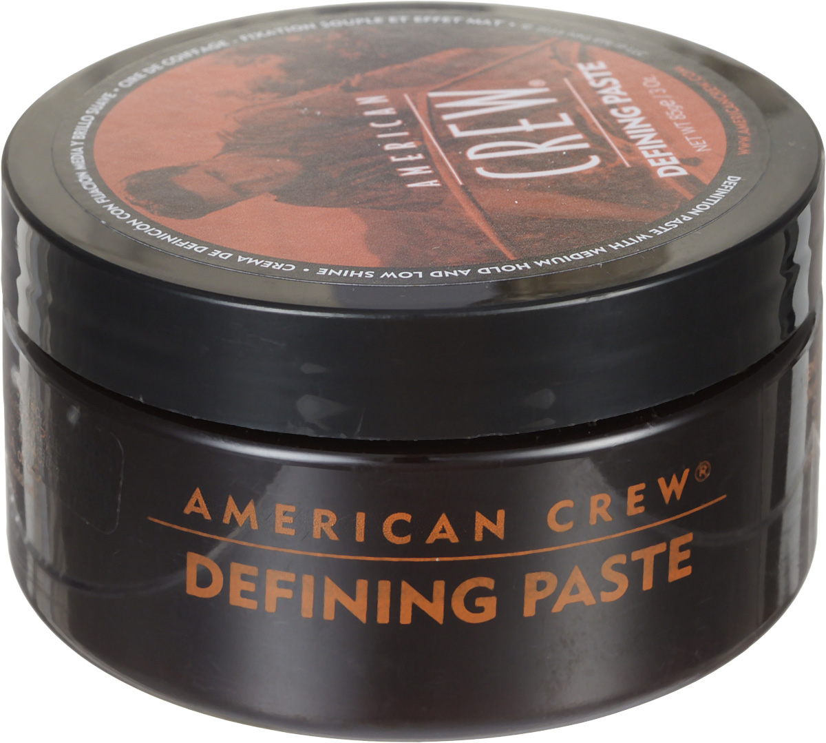 American Crew Паста для укладки волос Defining Paste 85 млMP59.4DПаста от компании American Crew предназначена для средней фиксации прически, обеспечивая низкий уровень блеска волос. Глицерин делает волосы густыми и объемными. Ланолин придает сверхсильную фиксацию. А пчелиный воск увлажняет волосы, при этом обеспечивая стойкость прически. Удобная текстура, сочетаясь с легкостью применения, делает это укладывающее косметическое средство очень привлекательным для применения.