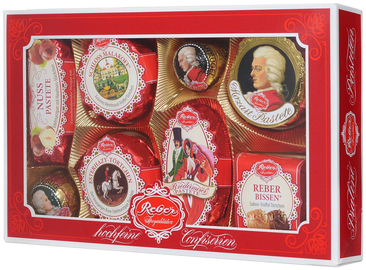 Reber Mozart подарочный набор шоколадных конфет, 285 г (коробка с окном)0120710Шоколадные конфеты от Reber Mozart - это не просто конфеты, это настоящие кондитерские шедевры. Впервые конфеты Ребер Моцарт были выпущены в 1890 году, через 100 лет после смерти великого Моцарта, и сразу завоевали невероятную популярность. Известные своим исключительным качеством, оригинальностью и изысканным дизайном, шоколадные деликатесы Reber в форме небольших подарочков - это настоящие драгоценности для ценителей.