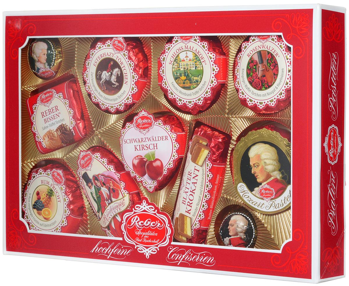 Reber Mozart подарочный набор шоколадных конфет, 380 г (коробка с окном)5060295130016Шоколадные конфеты от Reber Mozart - это не просто конфеты, это настоящие кондитерские шедевры. Впервые конфеты Ребер Моцарт были выпущены в 1890 году, через 100 лет после смерти великого Моцарта, и сразу завоевали невероятную популярность. Известные своим исключительным качеством, оригинальностью и изысканным дизайном, шоколадные деликатесы Reber в форме небольших подарочков - это настоящие драгоценности для ценителей.