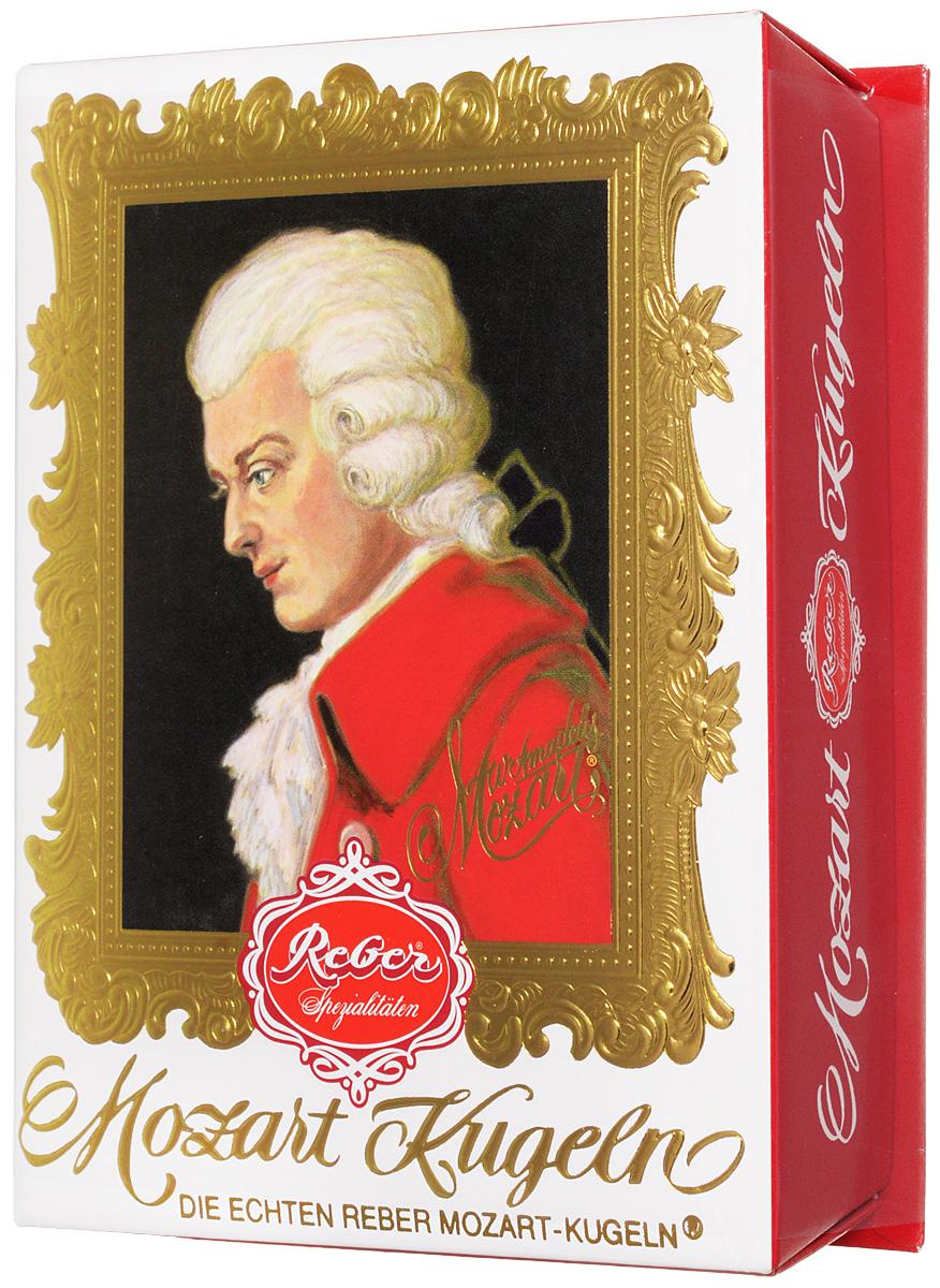 Reber Mozart Kugeln конфеты с горьким и молочным шоколадом, 120 г0120710Reber Mozart Kugeln - непревзойденные шоколадные конфеты, которые заполнены свежими зелеными фисташками, миндалем, фундуком, а сверху покрыты слоем горького и молочного шоколада.
