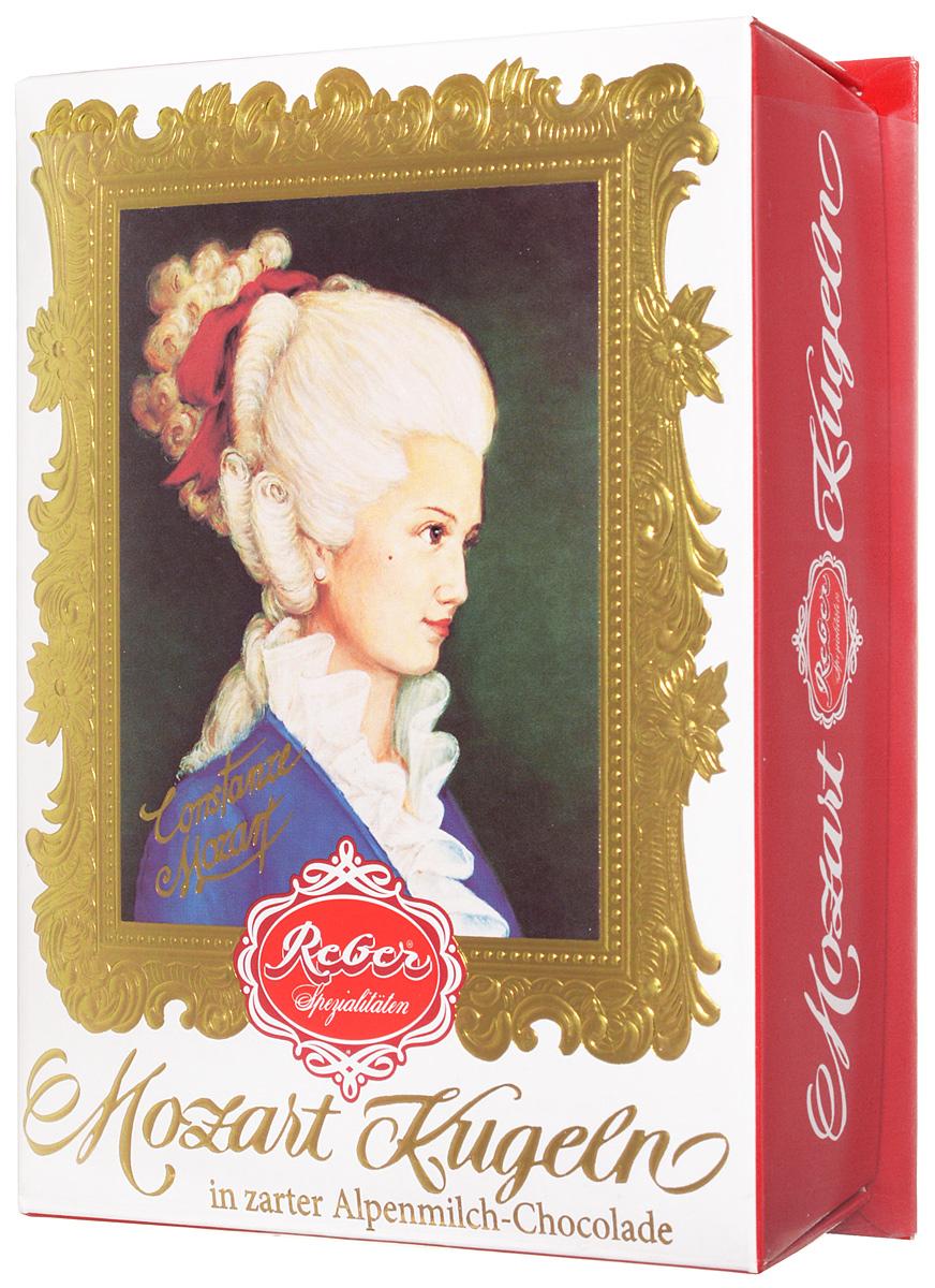 Reber Mozart Kugeln конфеты с молочным шоколадом, 120 г0120710Reber Mozart Kugeln - непревзойденные шоколадные конфеты, которые заполнены свежими зелеными фисташками, миндалем, фундуком, а сверху покрыты слоем настоящего молочного шоколада.