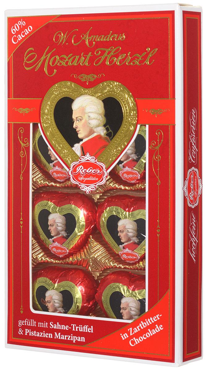 Reber Mozart Herz'l шоколадные конфеты, 80 г0120710Mozart Herz'l – великолепные конфеты, выполненные в форме сердечка. Состоят из зеленых фисташковых орехов расположенных в нежном сливочном трюфеле, а сверху покрыты отличным горьким шоколадом.