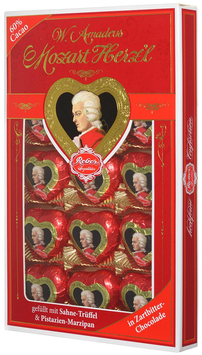 Reber Mozart Herz'l шоколадные конфеты, 150 г0120710Mozart Herzl - великолепные конфеты, выполненные в форме сердечка. Состоят из зеленых фисташковых орехов расположенных в нежном сливочном трюфеле, а сверху покрыты отличным горьким шоколадом.