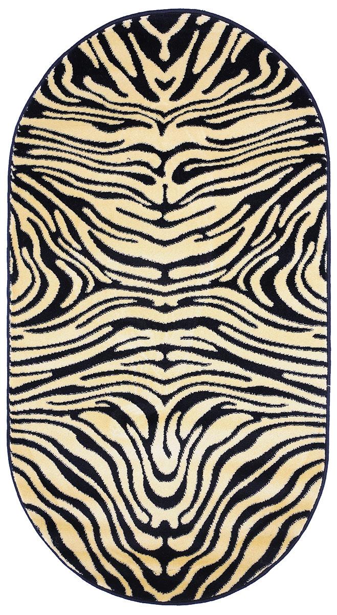 Ковер Kamalak Tekstil, овальный, 80 x 150 см. УК-003516050Ковер Kamalak Tekstil изготовлен из прочного синтетического материала heat-set, улучшенного варианта полипропилена (эта нить получается в результате его дополнительной обработки). Полипропилен износостоек, нетоксичен, не впитывает влагу, не провоцирует аллергию. Структура волокна в полипропиленовых коврах гладкая, поэтому грязь не будет въедаться и скапливаться на ворсе. Практичный и износоустойчивый ворс не истирается и не накапливает статическое электричество. Ковер обладает хорошими показателями теплостойкости и шумоизоляции. Оригинальный рисунок позволит гармонично оформить интерьер комнаты, гостиной или прихожей. За счет невысокого ворса ковер легко чистить. При надлежащем уходе синтетический ковер прослужит долго, не утратив ни яркости узора, ни блеска ворса, ни упругости. Самый простой способ избавить изделие от грязи - пропылесосить его с обеих сторон (лицевой и изнаночной). Влажная уборка с применением шампуней и моющих средств не противопоказана. Хранить рекомендуется в свернутом рулоном виде.