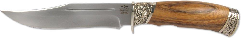 Нож Ножемир Беринг, булатная сталь, с ножнами, общая длина 27,6 см. (5483)бOF/BF-73За скромной внешностью ножа Ножемир Беринг скрывается настоящий бойцовский характер. Он выполнен в стилистике американских ножей-боуи, с которыми осваивали дикий запад. Клинок ножа выполнен из надежной булатной стали, которая известна благодаря своим уникальным качествам. Рукоять из дерева зебрано имеет необычный и красивый узор, напоминающий полоски зебры. Элементы художественного литья из мельхиора играют роль заключительного акцента, который завершает всю композицию.В комплекте чехол для переноски и хранения.Общая длина: 27,6 см.Твердость стали: 62-64 HRC.