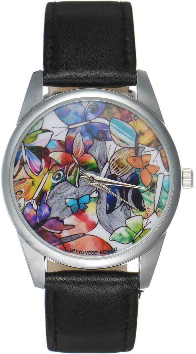 Часы наручные женские Mitya Veselkov Бабочки, цвет: черный, мультиколор. MV-169BM8434-58AEОригинальные часы Mitya Veselkov Бабочкипонравятся вам с первого взгляда. Корпус часов выполнен из стали, и дополнен задней крышкой. В центре корпуса располагаются круглые кварцевые часы с тремя стрелками. Циферблат оформлен оригинальным принтом с изображением бабочек. Часы оснащены кожаным ремешком, который фиксируется с помощью пряжки. Часы упакованы в фирменную упаковку в виде стакана. Такие часы станут отличным подарком человеку, любящему качественные и оригинальные вещи.