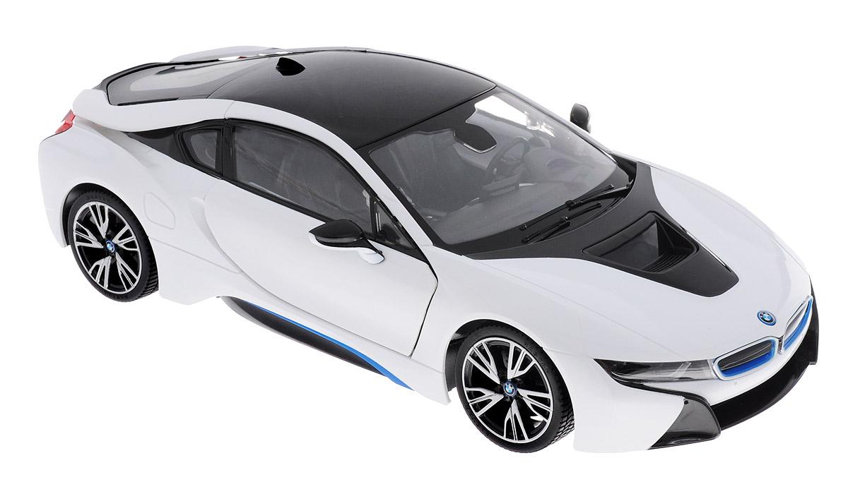 """Радиоуправляемая модель Rastar """"BMW i8"""" станет отличным подарком любому мальчику! Все дети хотят иметь в наборе своих игрушек ослепительные, невероятные и крутые автомобили на радиоуправлении. Тем более, если это автомобиль известной марки с проработкой всех деталей, удивляющий приятным качеством и видом. Одной из таких моделей является автомобиль на радиоуправлении Rastar """"BMW i8"""". Это точная копия настоящего авто в масштабе 1:14. Авто обладает неповторимым провокационным стилем и спортивным характером. Потрясающая маневренность, динамика и покладистость - отличительные качества этой модели. Машина может осуществлять движение вперед, назад, вправо и влево, при движении назад у нее загораются стоп-сигналы, при движении вперед - фары. Колеса игрушки прорезинены и обеспечивают плавный ход, машинка не портит напольное покрытие. Пульт управления работает на частоте 27 MHz. Радиоуправляемые игрушки способствуют развитию координации движений, моторики и ловкости, а также..."""