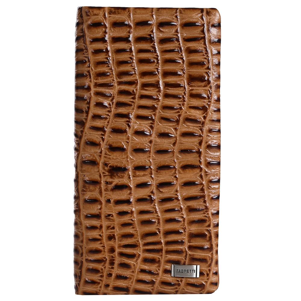 Кошелек женский Fabretti, цвет: коричневый. 73039490300нРоскошный женский кошелек от итальянского бренда Fabretti выполнен из натуральной мягкой кожи с роскошным тиснением под рептилию. Внутри изделия находятся два отделения для купюр. Вы с легкостью сможете расположить свои кредитные и дисконтные карты с помощью 12 отделений, а также одну любимую фотографию. Закрывается аксессуар на прочную и удобную кнопку.