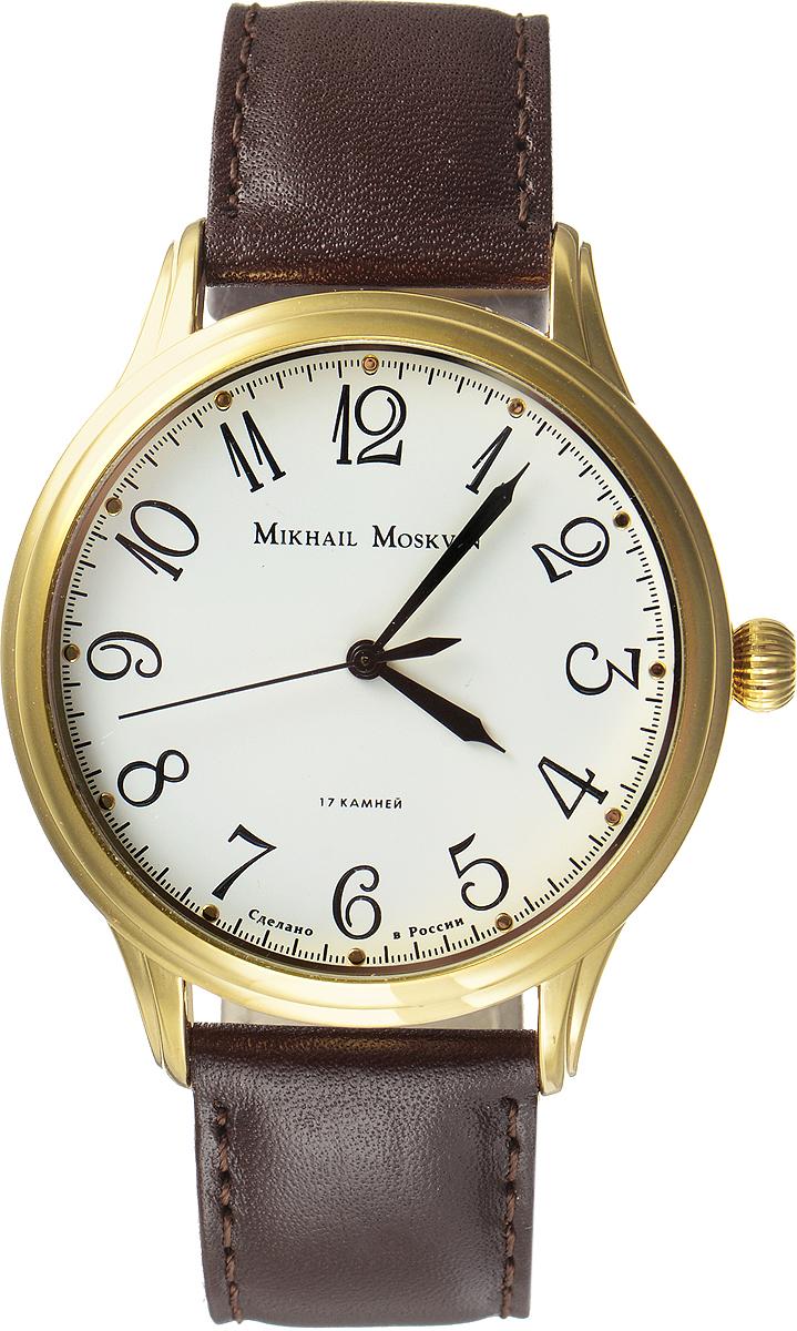 Часы наручные мужские Mikhail Moskvin, цвет: золотой, коричневый. 1113A2L6BM8434-58AEСтильные мужские наручные часы сдержанного классического дизайна Mikhail Moskvin изготовлены из высокотехнологичной гипоаллергенной нержавеющей стали и натуральной кожи. Модель органично сочетает в себе технологичность и строгость, оформлена символикой бренда. Для того чтобы защитить циферблат от повреждений в часах используется минеральное стеклом с сапфировым напылением.Для придания стойкости к коррозии и безупречного вида корпус покрыт по современной технологии - ионным напылением золотом высокой пробы. Циферблат изделия оснащен часовой и минутной и секундной стрелками.Часы оснащены надежным механическим механизмом ручного завода, степенью влагозащиты равной 3 Bar.Браслет комплектуется надежной и удобной в использовании застежкой-пряжкой, которая позволит с легкостью снимать и надевать часы, а также регулировать длину браслета. Часы Mikhail Moskvin подчеркнут мужской характер и отменное чувство стиля их обладателя.